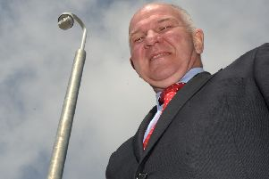 Councillor Watson McAteer alongside the surveillance camera watching over Hawick's Common Haugh car park.