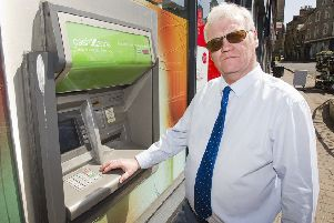 Councillor Davie Paterson at a cash machine in Hawick.