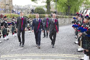 Callant Euan Munro flanked by Nick Arnold, Brodie Irvine and herald Rob Reid march  through a guard of honour to the town hall reception.