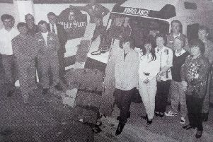 Kelso's White Swan pub makes a donation to the ambulance service in 1994.