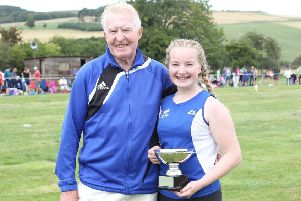 TLJT member Molly Noble, with coach Jock Steed, pictured at last year's Morebattle Games (library image).