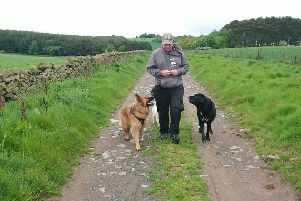 Kevin Motion with his dogs.