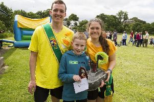 Principals Stefan Cameron and Emma Wauchope with Max Lee and his winning boat.