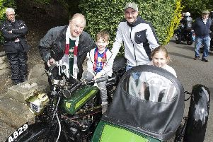 Alan Scott proudly displaying his Royal Enfield to Teddy, Adam and Ava Croudace at Wilton Park.