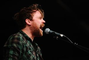 WOODFORD, AUSTRALIA - AUGUST 01:  Scott Hutchison of Frightened Rabbit performing on stage in 2010.  (Photo by Mark Metcalfe/Getty Images)
