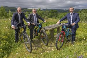 From left, UK Government ministers Jake Berry and David Mundell with Holyrood's Michael Matheson at Glentress today to sign off the Borderlands growth deal.