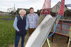 Kelso community councillors Colin McGrath and Dean Weatherston at the playpark next to the High Croft Co-op.