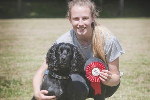 Proud owner Melissa Whittet at last year's show with the winner of the prize for most handsome dog winner, Ben the cocker spaniel.