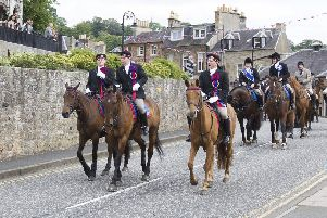 The cavalcade leads town on Saturday morning.