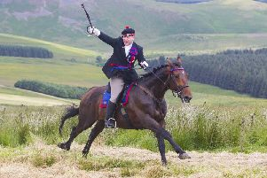 Callant Euan Munro gives the battle cry Jethart's Here as he gallops up Carter Bar.