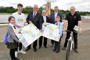 North Lanarkshire Council leader Jim Logue and Councillor Michael McPake help launch the new map and app at Strathclyde Park with pupils from Bellshill Academy, St Bernadette's and Ladywell Primaries, and representatives from council services.