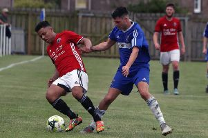 Gala Fairydean Rovers'  Alex Chingwalu holds off Shane Bonnington in their match against Coldstream (picture by Steve Cox).