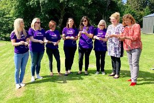 Pictured are Susan Simpson, Joanne Murray-Stewart and Members of the SiMBA Support Group Releasing butterflies for the families who could not attend.