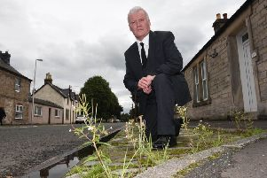 Hawick councillor Davie Paterson by the B6357 in Newcastleton.