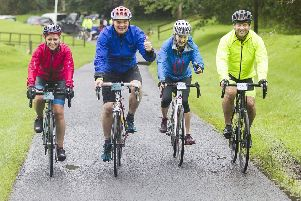 After a brief refreshment break at Jed-Forest rugby club the cyclists were marshalled back on to the A68