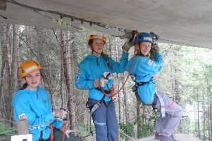 Girl Guides from across the Tweed Valley have returned home from a trip to Switzerland.'The group, aged 12-13, took part in a host of activities, including hiking, white-water rafting, climbing, ziplining and highropes (pictured)