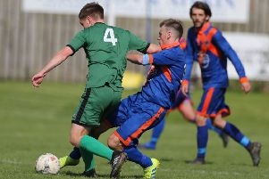 Liam Lavery, in blue, goes in for a challenge against Stirling University. The Hawick man was later one of two home players to see red (picture by Brian Sutherland).