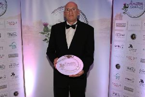 Robert Mackie with his trophy for best funeral director (North).