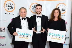 Trevor, Ryan and Tracey Ward of the Fleece in Selkirk with their prize for best Scottish cuisine at this year's Food Awards Scotland.