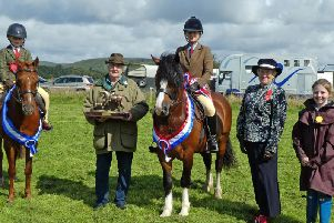 Stranraer & District Riding Club Charity Horse Show winners Megan McIlwraith (left), Louise Maxwell (centre) and Zoe McConnell (right), with judges Sue Mattison and  Bobby Holme.