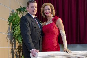 Society chairperson Julia Wailes-Fairbairn with Alan Thomson in its 2018 production of Dirty Rotten Scoundrels.