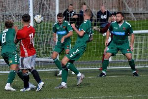 Berwick 'keeper Sean Brennan, second right, saves a header from Gala's Jack Cowan, srurrounded by plenty team mates in green (picture by Alwyn Johnston).