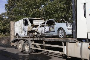 Burnt out cars ar towed away from Rooster's Auto Repairs, Edinburgh Road, Jedburgh.