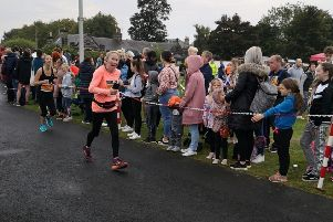 72-year-old Liz Lisle from Kirk Yetholm finishes the Scottish Half Marathon yesterday.