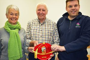 Graham Waters and his wife Moira show Jack Waters' British Lions cap to Bryan Hoggan during last week's visit to Selkirk.  Photo  JOHN SMAIL
