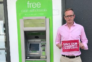 Borders MP John Lamont at a cashpoint in Chirnside.