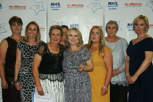 The School Immunisation Team collects the NHS Borders Values Award.