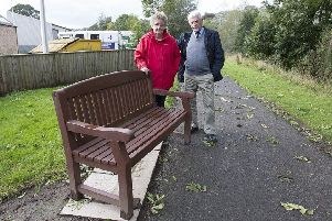 Local resident Mary Ferguson dismayed over vandalism of benches in Jedburgh with councillor Jim Brown.
