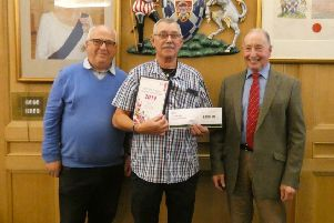 Henry Wear from Jedburgh Horticultural Society collects the town's two awards.