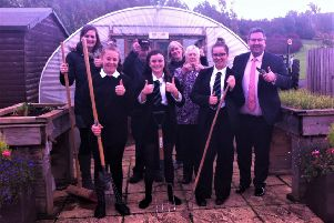 Gardeners celebrating landing a grant of over �8,000 to further develop a community garden in the grounds of Earlston High School.