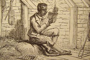 An etching of Tom Jenkins studying by candlelight.