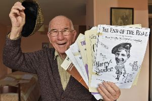 Bert Armstrong pictured at home with his singing books in 2017.